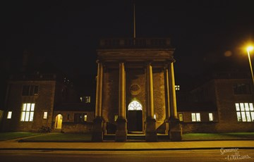 Front of Rhodes House at night