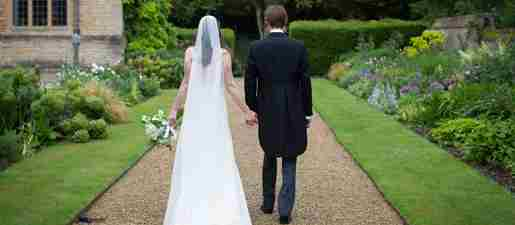 rhodes house bride and groom along path in garden courtesy of jess orchard photography