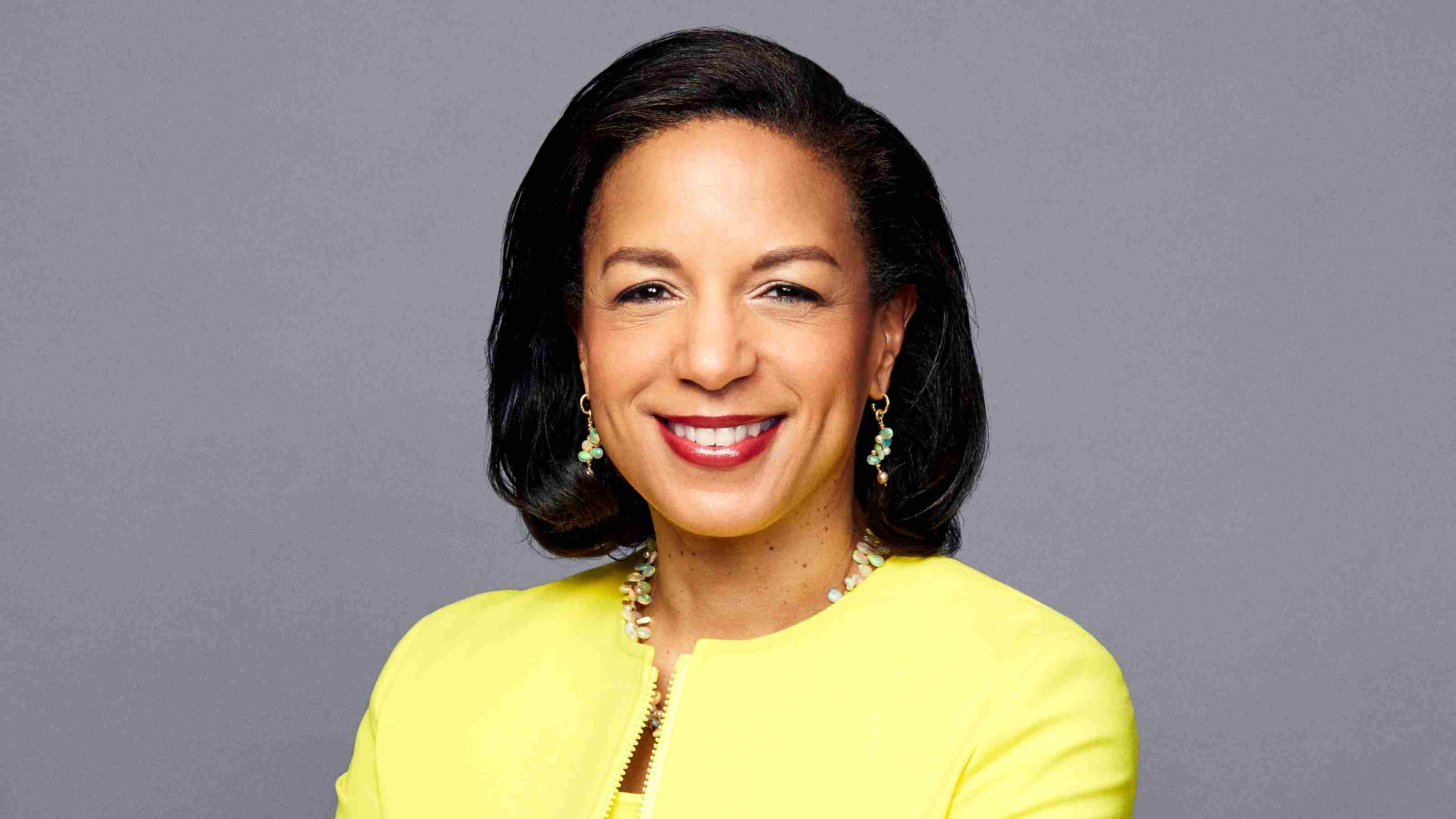 Headshot of Susan Rice. Susan is wearing a yellow jacket and is smiling at the camera.