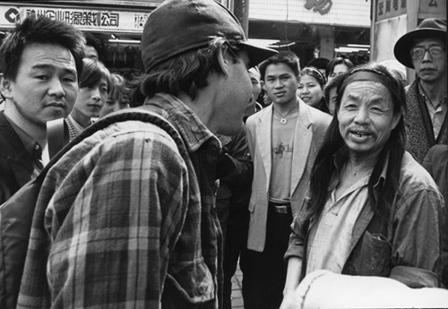 Peter Hessler talking in the street in Fuling, China, in 1998